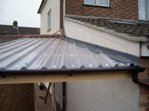 Above Left, A Very Old Pvc Corrugated Roof, Which Is Now Beyond Repair,  Above Left The New Roof We Fitted To The Conservatory, Which Is Filon, A  Fibreglass ...